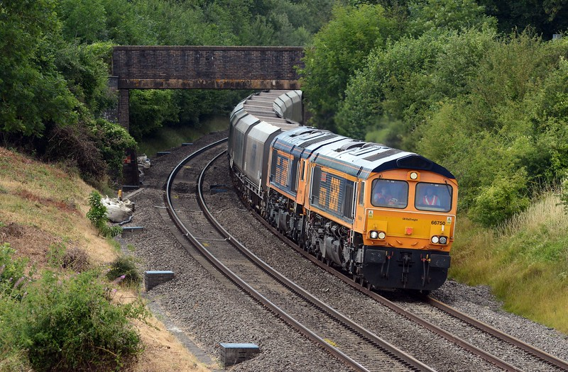 GBRf's returning 4V78 Washwood Heath to Cardiff Docks with 66750 Bristol Panel Signalbox and 66760 David Gordon Harris DIT. Network Rail appear to be carrying out some undergrowth clearance on the left. I hope they dodn't stint on it.