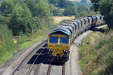 The first of the day's two coal empties from Fiddlers Ferry to East Usk, 4V20 behind 66549.