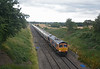 GBRf's 6M35 Gloucester to Clitheroe Hanson cement empties with 66766