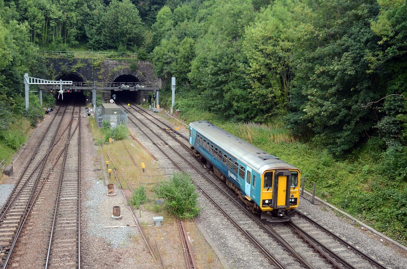 The 14:55 Newport to Llanelli - Cardiff, Bridgend and all stations - crossing from relief to main.