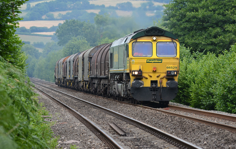 A 6V75 running on a Wednesday is unusual to say the least. Only 12 wagons so by no means a challenging load empty. 66529 is approaching the Offa's Dyke footpath crossing in Pandy a few minutes behind schedule.