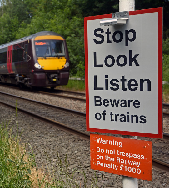 On the Leicester Line this footpath crossing has been equipped with solar powered lights to illuminate the Stop Look Listen warning sign.