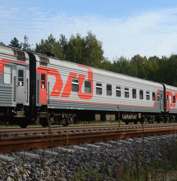 An RZD passenger car, either a Spalny Vagon (2 berth compartments), Kupeiny (4 berth compartment) or a Platskartny (open plan with bunks).