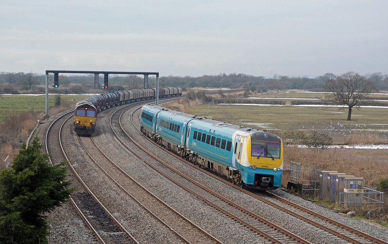 66079 on the 6H25 Margam to Llanwern being passed by the 11:22 Cardiff to Holyhead