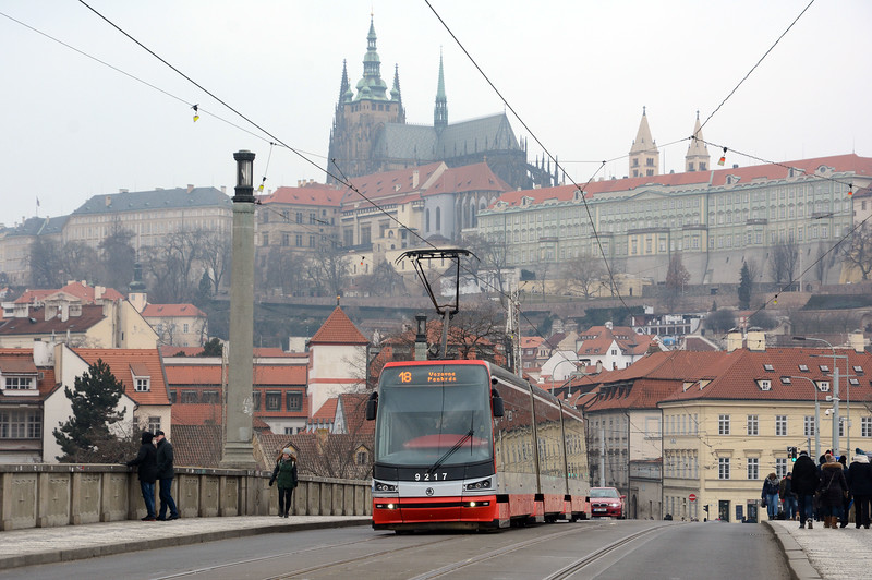A Skoda 15T crosses Manesuv Bridge with Prague Castle in the background