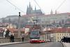 A Skoda 15T crosses Manesuv Bridge with Prague Castle in the background