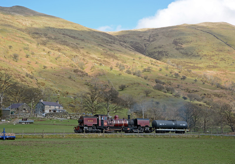 138 and its tank car passes Caeau Gwynion farm