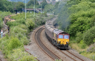 66194 puts on power whilst 70807 appears to be hiding in the bushes.