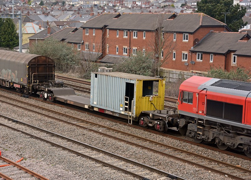 You can easily identify Birdport bound trains which, if they are not topped and tailed, include this strange contraption in the consist, an FAA intermodal flat carrying a 1TEU container, complete with yellow end, which is used to control back up moves down the Birdport branch. They used to use a Shark ballast brake but now this does. <br /> <br /> Sophisticated ain't it :-)