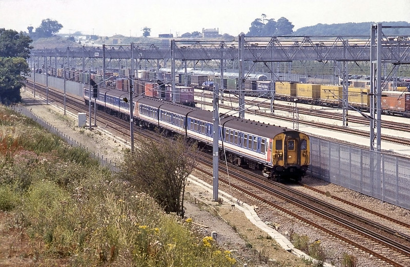 The 12:25 Victoria to Folkestone passing a full looking Dollands Moor.