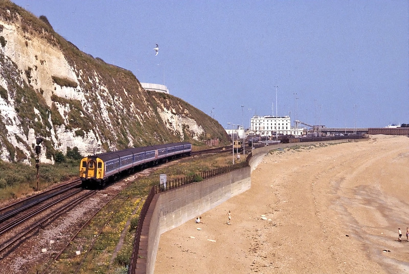 Later the same day the 14:40 from Dover to Victoria approaching Shakespeare Cliff Tunnel, the bulk of the 1853 Lord Warden Hotel is centre stage, Western Docks is on the right. the 08s are to shunt the train ferry yard.