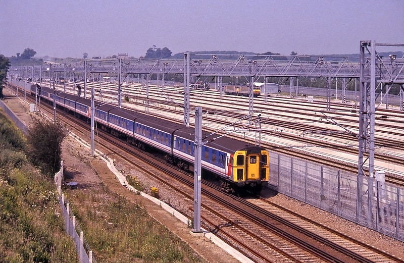 Passing Dollands Moor Yard, complete with a pair of the SNCF BB22200 electrics which for a short period in 1994 and 1995 hauled freight trains through the tunnel. The train is the 09:25 Victoria to Folkestone Harbour and, unusually that summer, formed of 12 cars