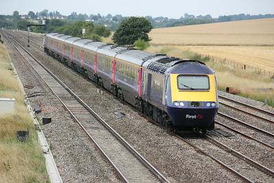 FGW 125 passes Cholsey Manor Farm with 1131 Weston Super Mare - Paddington 26/7/14