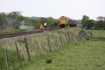 33102 pauses on the approach to Lower Lady Meadows Crossing as crew and local residents put out a lineside fire started by 69621 on the outward run 3/5/14