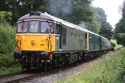 33109 on its debut run following its superb repaint into Departmental Grey, passes Townsend Fold on the approach to Rawtenstall, paired with 73001 working the 1215 Heywood - Rawtenstall 7/7/17