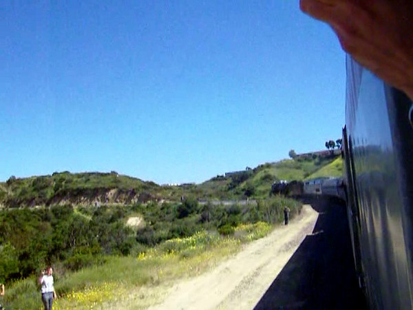 San Diego Steam Special 2010, southbound on 5-1-10.  Trespassing photographers and a changing signal are seen trackside as Santa Fe 4-8-4 No. 3751 and excursion train round a second sweeping curve, further along on the 2.2% grade of Miramar Hill.  A little less wind and a lot more train in this shot!