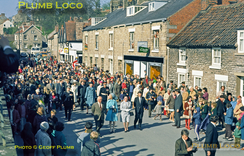 Having arrived aboard the Royal opening special train from Grosmont, HRH The Duchess of Kent, accompanied by local dignitaries and a large crowd of well-wishers, is now walking from Pickering station to the Black Swan Inn, where the final plaque was unveiled and the NYMR opening formalities concluded. Tuesday 1st May 1973. Slide No. 11091.