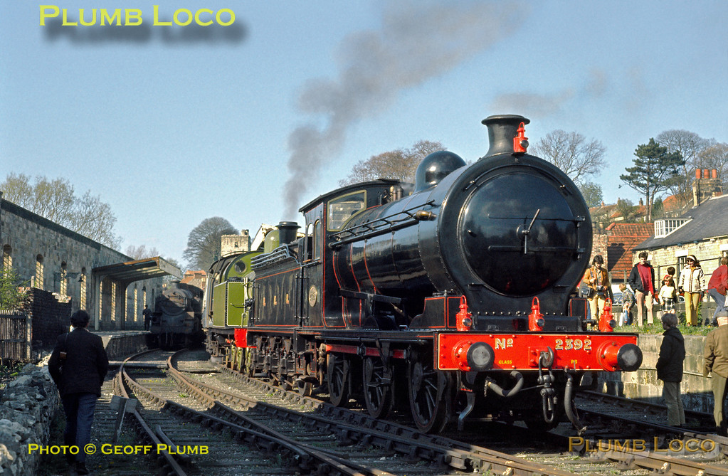 Having worked the official opening Royal train from Grosmont with HRH The Duchess of Kent on board, NER P3 Class 0-6-0 No. 2392 and LH&JCR 0-6-2T No. 29 have now arrived at Pickering station, southern terminus of the line. The official party made their way to the Black Swan Inn for the final formalities of the day, while the locos basked in glory and sunshine! Tuesday 1st May 1973. Slide No. 11090.