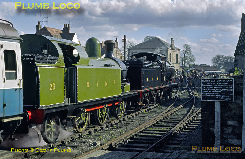 Having worked the official opening Royal train from Grosmont with HRH The Duchess of Kent on board, NER P3 Class 0-6-0 No. 2392 and LH&JCR 0-6-2T No. 29 have now arrived at Pickering station, southern terminus of the line. The official party made their way to the Black Swan Inn for the final formalities of the day, while the locos basked in glory and sunshine! Tuesday 1st May 1973. Slide No. 11087.