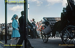 After unveiling the plaque earlier at the Angel Hotel, HRH The Duchess of Kent was driven in a horse-drawn carriage to the Royal Hotel on the West Cliff for a formal lunch and is now departing once again from the Royal Hotel to be taken to Grosmont to join the official inaugural train. Originally, this was to have run from Whitby but a national rail strike that day meant this couldn't happen, so the horse-drawn carriage simply took the Duchess back to her car for the trip to Grosmont. Tuesday 1st May 1973. Slide No. 11027.