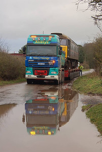 The convoy halted briefly outside the gate to enable manual rear steering of the trailer to be operated. A handy puddle as well. 22nd December 2011