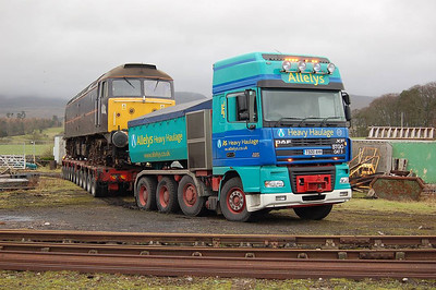 The truck, trailer and loco in the yard, having come to grief in the soft ground on 22nd December 2011