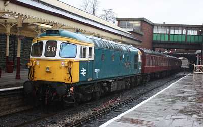 33109 'Captain Bill Smith RNR' arrives at a very wet Bury with the 1015 Rawtenstall - Heywood 15/2/14