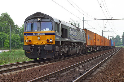 Shortlines' Class 66 PB01 heads a southbound container train from Rotterdam through Dordrecht Zuid. 10th June 2004.