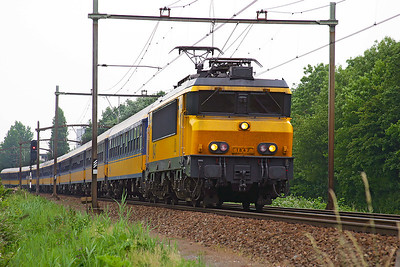 Shortly after departing from Dordrecht 1847 heads a southbound Intercity service from Amsterdam CS through Dordrecht Zuid. 10th June 2004.