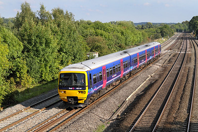 The 15.57 Paddington to Banbury formed of 165101 passes Lower Basildon. 02/09/2011