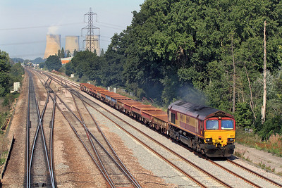 Fresh from store and repair, 66147 powers past didcot East junction with 6O26 10.19 Hinksey Yard to Eastleigh Yard engineers train. 02/09/2011