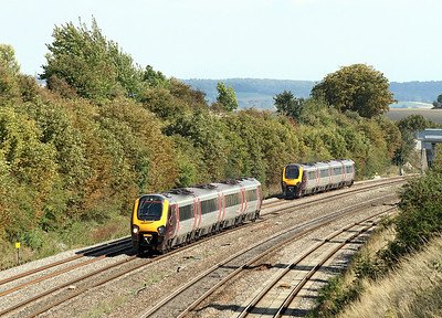 220022 forming the 13.46 Southampton to Edinburgh heads through Moreton Cutting as the 10.35 Newcastle to Reading heads away. 02/09/2011