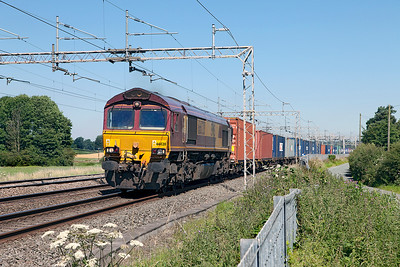 From 10.00am until late afternoon following an axle counter failure, all southbound freights were routed on the Up Fast, which made photography difficult. 66020 passes Mill Meece with 4O21 09.15 Trafford Park Euro Terminal to Southampton West Dock Intermodal service. Tuesday 19th July 2016.