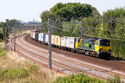 70007 has charge of 4L92 14.03 Ditton to Felixstowe North FLT Freightliner service rounding the curve at Heamies Farm. Tuesday 19th July 2016.