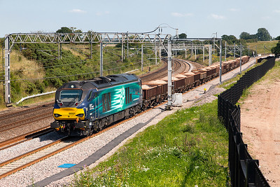 68001 'Evolution' passes Heamies Farm with 6U77 13.42 Mountsorrel Sidings to Crewe Basford Hall loaded ballast wagons. Tuesday 19th July 2016.