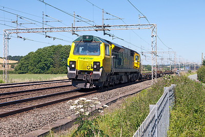 70002 heads a very lightly loaded 4M27 09.30 Coatbridge FLT to Daventry IRFT passing Mill Meece. Tuesday 19th July 2016.