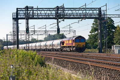 Lickey Banker 66057 passes Mill Meece with 6M90 05.06 Avonmouth Hansons Sidings to Clitheroe Castle Cement empty tanks. Tuesday 19th July 2016.