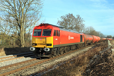Freshley repainted 60011 heads the 6B13 05.05 Robeston to Westerleigh Murco Terminal loaded tanks at Gossington.