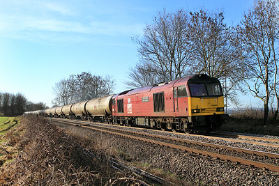 60040 heads the 6E41 11.41 Westerleigh Murco Terminal to Lindsey empty tanks past the Gossington foot crossing.