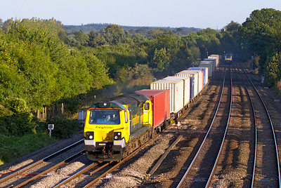 70017 heads through the evening shadows at Lower Basildon with 4M99 16.57 Southampton to Trafford Park Freightliner. Wednesday 5th September 2012.