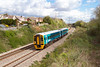 158822 in the new Arriva Trains livery passes Portskewett on a Cheltenham Spa to Maesteg service. Wednesday 11th April 2012.