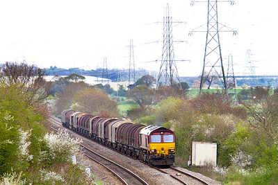 66120 gets to the end of the long straight approaching Portskewett with 6V05 09.10 Round Oak to Margam empty steel carriers. Wednesday 11th April 2012.