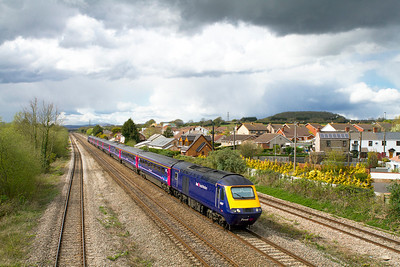 With a hail storm brewing overhead 43187 & 43012 pass Magor with the 13.55 Cardiff Central to Paddington. Wednesday 11th April 2012.