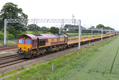 66156 heads north on the slow at Sandy Lane, Cranberry, Staffs with 6K50 15.10 Toton to Crewe Engineer's Train. 390052 on a working from Liverpool has just passed in tghe opposite direction and is approaching the site of Standon Bridge Station. 24/06/2011