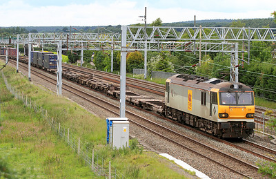 92034 'Kipling' heads the 4M63 10.21 Mossend to Hams Hall Intermodal past Sandy Lane, Cranberry, Staffs. 24/06/2011