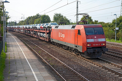 152 034 heads east through Saarmund with a well loaded car train. 24th September 2010.