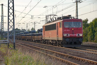 155 130 with a train of wire coils heads eastbound at Saarmund. 24th September 2010