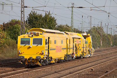 A pair of track machines head westbound through Saarmund. 24th September 2010.