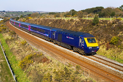 FGW power cars 43164 & 43187 pass Scorrier in charge of 1C81 11.36 Paddington to Penzance. Tuesday 2nd April 2013.