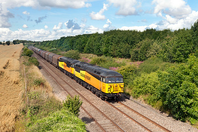 56087 & 56113 pass Pig Lane, Farleaze with 6Z16 09.24 Llanwern to Washwood Heath loaded steel carriers. Monday 4th August 2014.